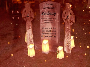 gravestone with candle and butterfly Lindsay