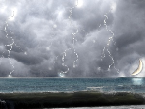 ocean hitting the beach with lightning strikes and the moon copy
