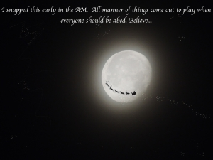 Santa flying past moon with words