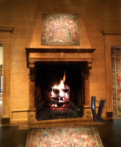 fireplace with fire 2 copy with tapestry and riding boots