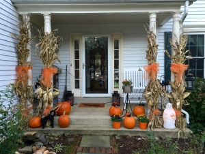 house with pumpkins and corn stalks